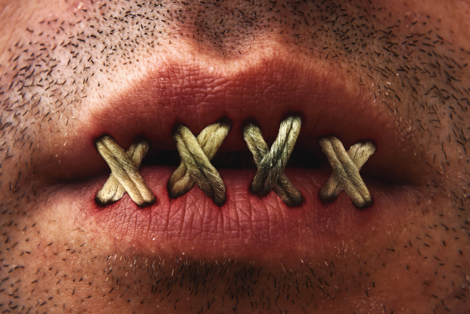 bigstock-Sewn-Mouth-35966338